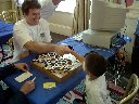6-year-old Liao Xingwen defeats top program at Go