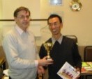 Lianpeng Zhang receives trophy from Tony Atkins