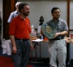 Jaeup Kim receives trophy from Ron Bell